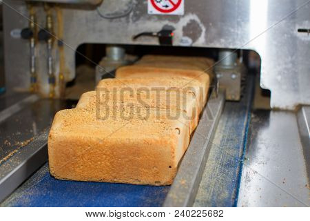 Industrial Bread Production Line.the Machine For Cutting And Packing Bread At The Factory