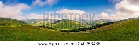 Panorama Of Beautiful Countryside In Autumn. Beautiful Landscape With Forested Mountains In A Distan