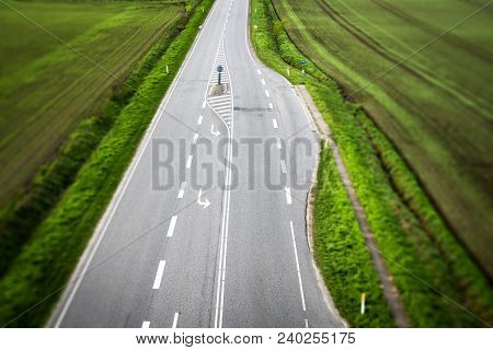 Highway Road With White Stripes With Rural Fields On Both Sides Seen From Above