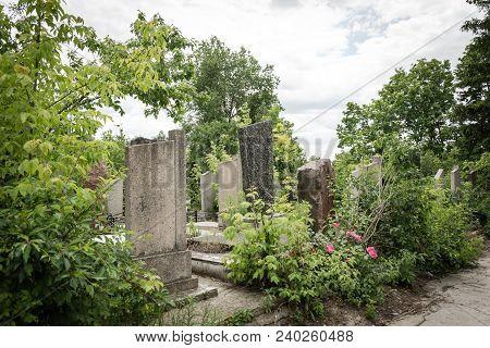 Memorial Stone Of Granite Slabs In The Jewish Cemetery