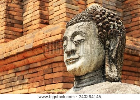 Sand Stone Buddha Statue Red Brick Background