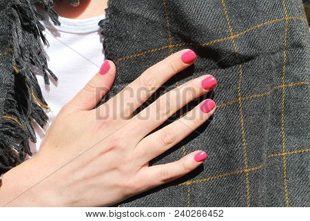 Beautiful Female Hand With Manicure. Saturated Bright Pink Nail Polish And And Groomed Fingers