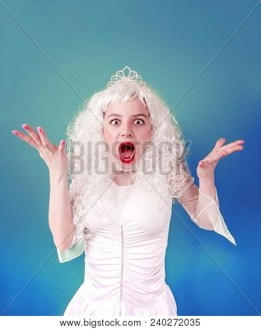 Waist Up Portrait Of A Crazy Girl Expressing Her Surprise. She Is Standing In White Wig And Laughing