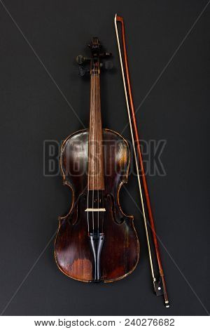 Classical Used Violin With Bow On Black Background