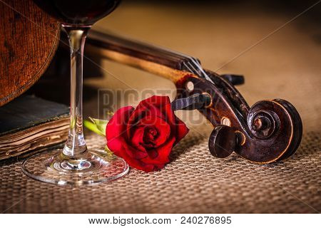 Old Violin Scroll Close With Red Rose And Wine Glass