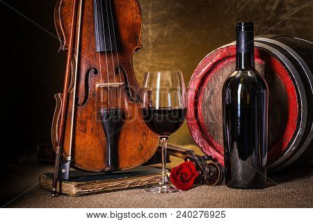 Details: Red Wine In Glass, Barrel And Violin