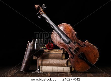 Old, Classical Violin With Books And Red Wine