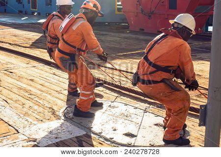 Anchor-handling Tug Supply Ahts Vessel Crew Preparing Vessel For Static Tow Tanker Lifting. Ocean Tu