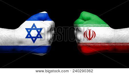 Flags Of Israel And Iran Painted On Two Clenched Fists Facing Each Other On Black Background/israel