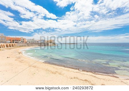 Gallipoli, Apulia, Italy - Relaxing At The Beach Of A Middle Aged City