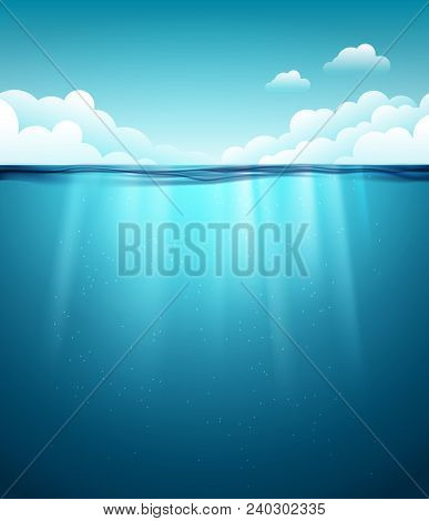 Underwater Ocean Surface. Blue Water Background. Clean Nature Sea Underwater Backdrop With Sky.