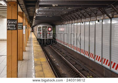 New York City - April 20, 2018: 3 Train Leaving The Grand Army Plaza Subway Station On The Nyc Subwa