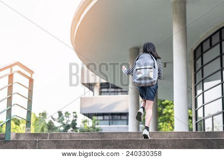 Back To School Education Concept With Kid (elementary Student Girl) Carrying Backpacks Going, Runnin