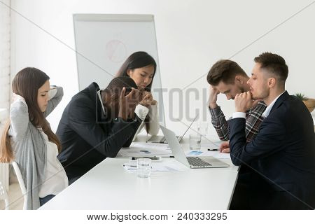 Stressed Multiracial Team Thinking Of Problem Solution At Emergency Office Meeting, Sad Diverse Busi