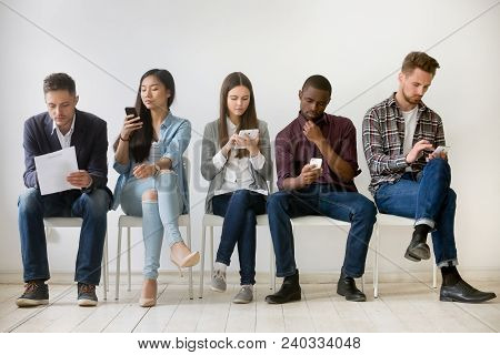 Diverse Millennial Unemployed People Waiting In Queue Preparing For Job Interview, Multi-ethnic Cand