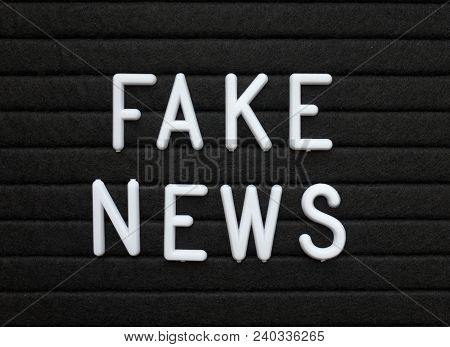 The Words Fake News In White Plastic Letters On A Black Letter Or Bulletin Board