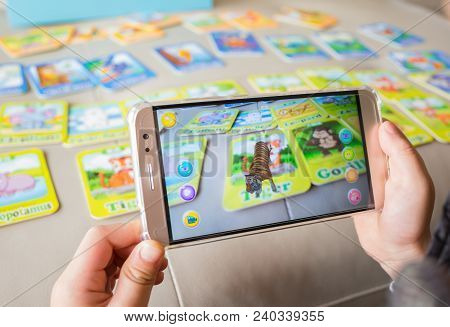 Zhongshan,china-december 30, 2017:kid Playing Augmented Reality Popup Of Tiger Via Mobile. Ar And Vr
