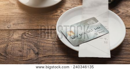 Restaurant Bill For Coffee And Credit Card On Wooden Table, Paying For Lunch At Cafe, Copy Space