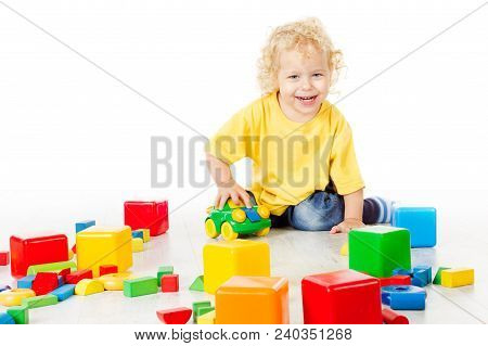 Child Play Blocks Toys, Kid Sitting On Floor And Playing Colorful Building Bricks, Baby Boy Isolated