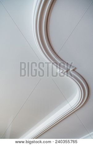 Curved Decorative Clay Stucco Relief Molding On White Ceiling In Abstract Classical Style Interior.