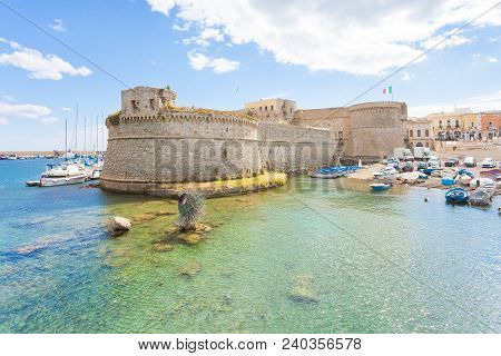 Gallipoli, Apulia, Italy - May 2017 - View From The Seaport Towards The Middle Aged Fort Of Gallipol