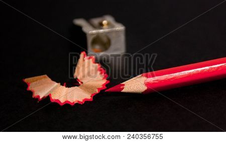 Red Pencil With Pencil Shavings And Pencil Sharpener Up Close