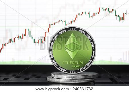 Ethereum Classic (etc) Coin; Ethereum Classic Cryptocurrency On The Background Of The Trading Chart