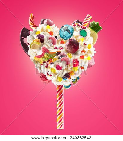 Sweet Lolipop In Heart Form Of Whipped Cream With Sweets, Jellies, Heart Front View. Crazy Freakshak