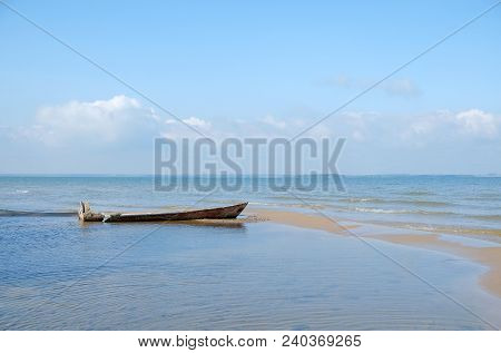 Old Destroyed Fishing Boat On The Shore Of A Sand Spit In The Ob Sea, Siberia, Russia. Sunny Summer