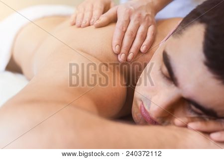 Body Massage At Physiotherapist Office. Handsome Man Getting Professional Spine And Back Treatment.