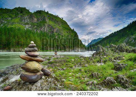Stone Pyramids On Katun River Coast In Altai Mountains. Chemal, Altay Republic, Siberia, Russia.