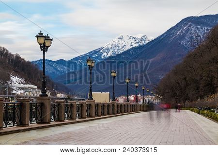 Landscape Of The Embankment Of Mzymta River On The Background Of Showy Mountains In Winter Day, Kras