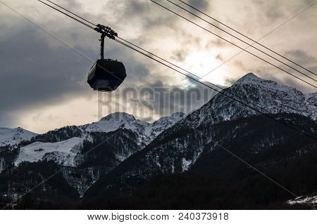 A Cabin Of The Cableway In Krasnaya Polyana On The Background Of Snowy Mountains, Sochi, Russia