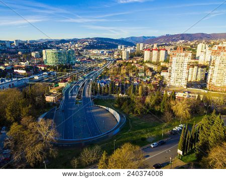 Drone View Of City, Mountains And Doubler Of Kurortny Prospekt Highway At Sunset, Sochi, Russia