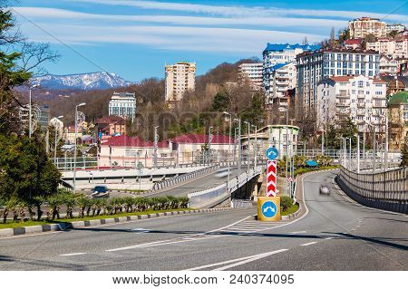Cityscape With Kurortny Prospekt O The Background Of Mountains And Apartment Buildings In Sunny Day,