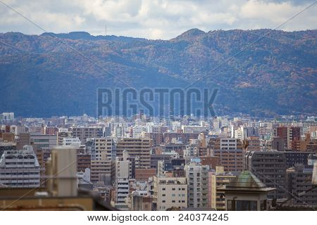 Kyoto, Japan - November 25, 2016 City View With Autumn Mountain Background Of Kyoto, Japan.