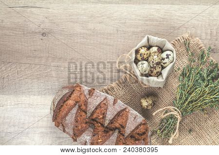 Thyme Bunch, Quail Eggs And Rye Bread On The Wooden Background With Copy Space, Toned Photo.