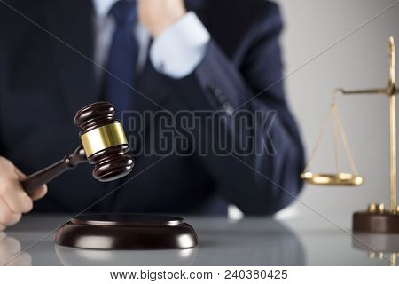 Law Concept. Judge, Gavel And Balance. White Background. Man In Suit.
