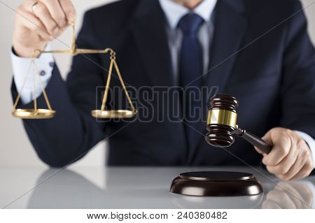 Law Concept. Judge With Gavel And Balance. White Background. Man In Suit.