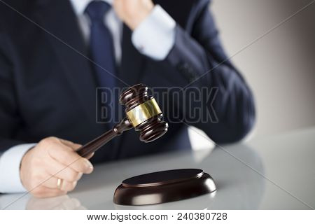 Law Concept. Judge With Gavel. White Background. Man In Suit.