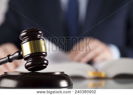 Law Concept. Judge, Gavel, Legal Code. White Background. Man In Suit.