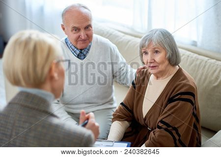Anonymous Therapist Having Meeting With Elderly Patients In Nursing Home Giving Consultation.