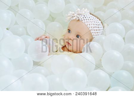 Baby Girl Playing In A Ball Pool