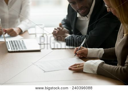 Businesswoman Signing Business Document At Meeting With African Partners, Satisfied Client Customer