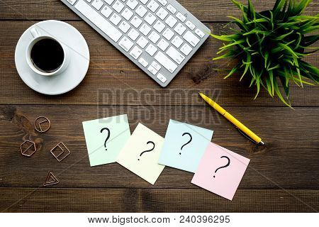Question Mark On Sticky Notes On Office Desk On Dark Wooden Background Top View. Faq Concept. Workin