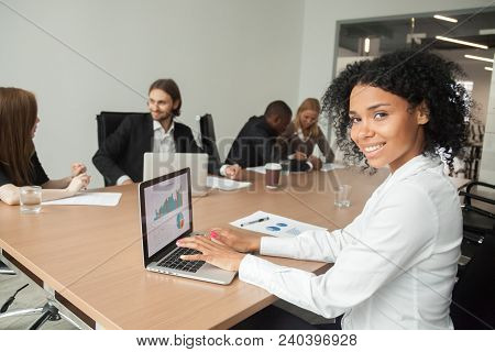 Smiling Millennial African Businesswoman Looking At Camera At Meeting, Female Afro American Marketin