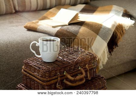 A Cup Of Hot Tea With A Book, Glasses, A Blanket On The Couch