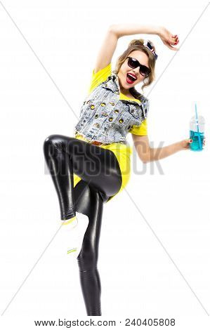 Happy Youth Lifestyle Concepts. Closeup Of Upbeat Caucasian Blond Girl Dancing With Cup Of Blue Cock