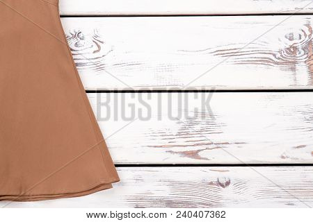 Female Brown Skirt And Copy Space. Women Long Vintage Skirt On White Wooden Background. Feminine Gar
