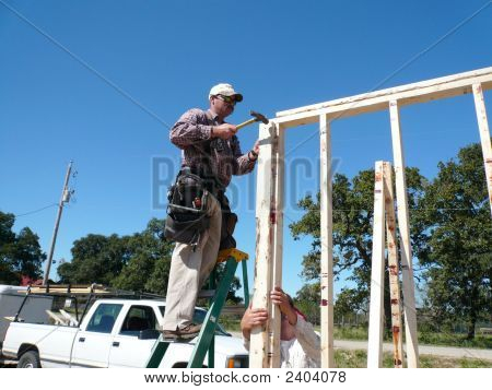 Man On Ladder Hammering
